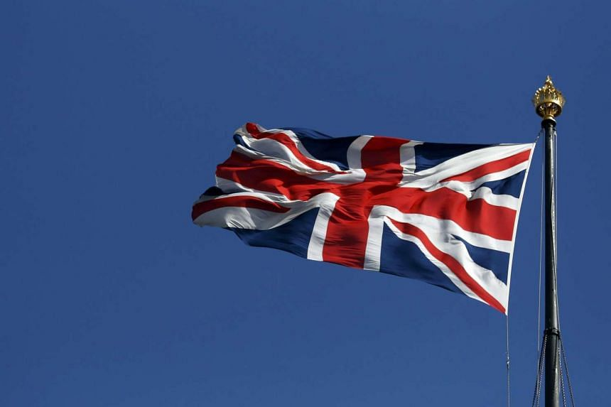 The union flag flies over the Houses of Parliament in Westminster, in central London.