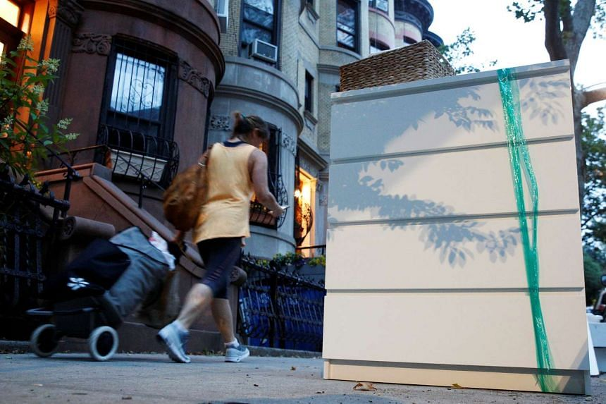 An Ikea Malm dresser placed by the road in a Brooklyn neighbourhood of New York City.