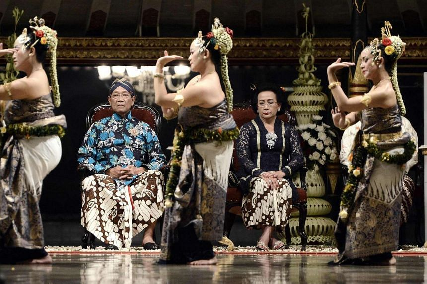 Sultan Hamengku Buwono X (left) watches a dance performance to celebrate his 70th birthday and 27th year in power.