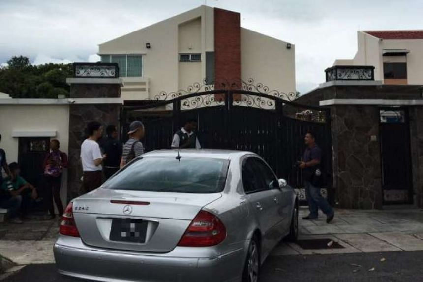 Reporters stand outside Penang Chief Minister Lim Guan Eng's Pinhorn Road bungalow in this file photo.
