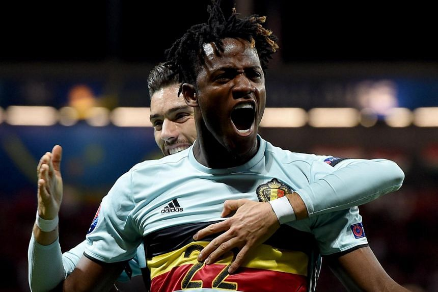 Michy Batshuayi of Belgium (front) celebrates scoring with Yannick Ferreira Carrasco during the Uefa Euro 2016 round of 16 match between Hungary and Belgium.
