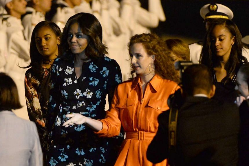 Michelle Obama is welcomed by Moroccan Princess Lalla Salma at Marrakech International Airport.