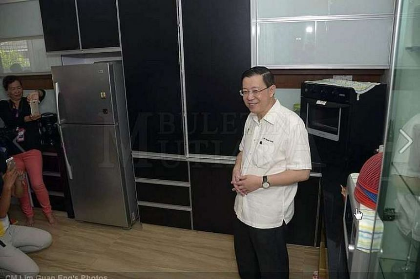 Mr Lim and about 30 newsmen at his RM2.8 million (S$940,000) two-storey bungalow.
