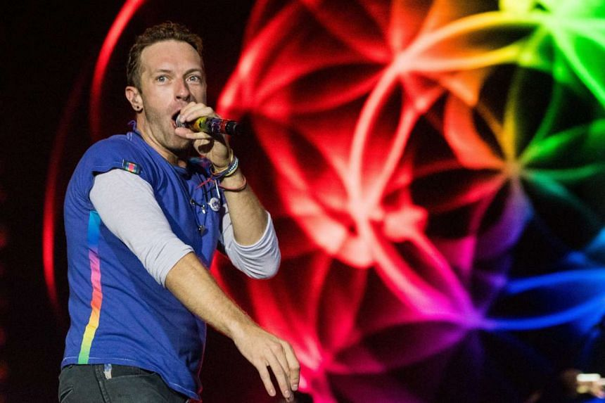 Coldplay's Chris Martin sings as the band headline on the Pyramid Stage on the final day of the Glastonbury Festival in Somerset, England, on Sunday.