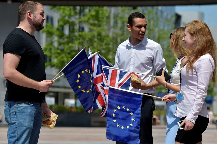 British students with UK and EU flags in Brussels on June 23, 2016, ahead of the Brexit vote.