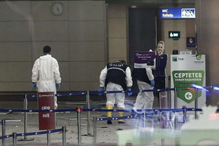 Police investigators search the area after a suicide bomb attack at Ataturk Airport in Istanbul, Turkey, June 28, 2016.
