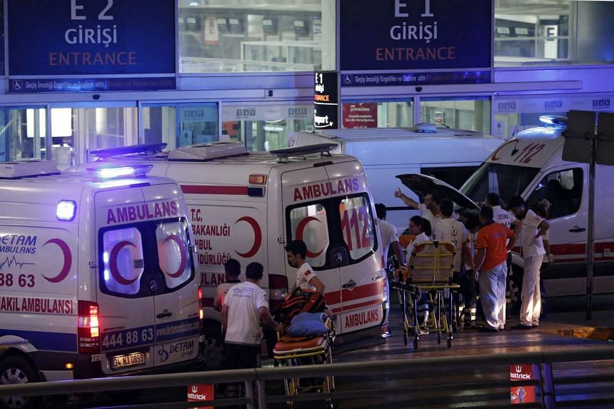 Medics help wounded people after a suicide bomb attack at Ataturk Airport in Istanbul, Turkey,  June28,  2016.