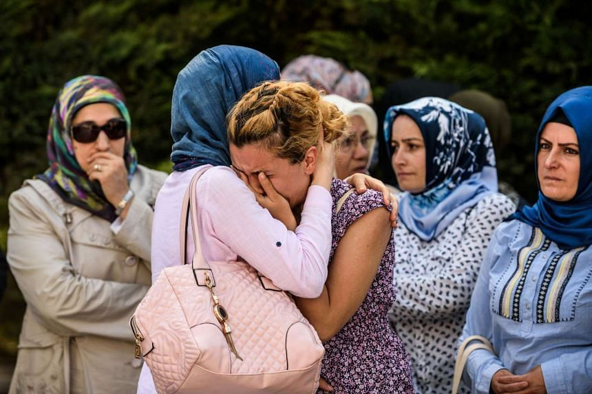 Relatives of suicide attack victim Mohammad Eymen Demirci mourn on June 29, 2016 in Istanbul.