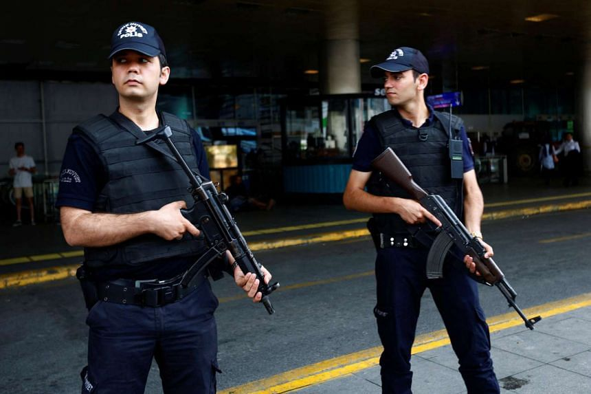 Police officers stand guard at Ataturk airport in Istanbul, Turkey on June 30, 2016.