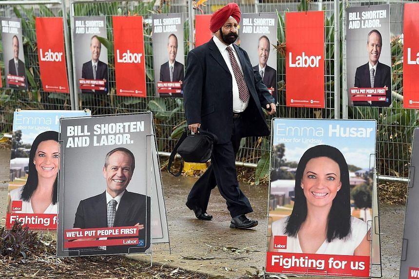 Labor Party posters in Sydney. Both the ruling Liberal-National Coalition and the opposition Labor Party have sought to appeal directly to ethnic voters ahead of Saturday's elections.
