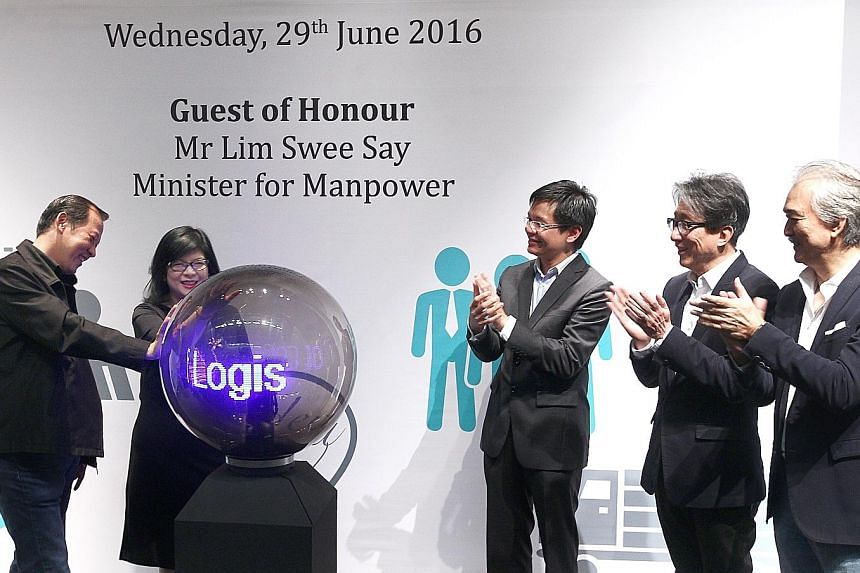 Manpower Minister Lim Swee Say (second from right) at the Logistics PCP launch yesterday with (from left) Scala academy director Paul Lim; WDA enterprise development group senior director Julia Ng; WDA chief executive Ng Cher Pong; and Scala founding