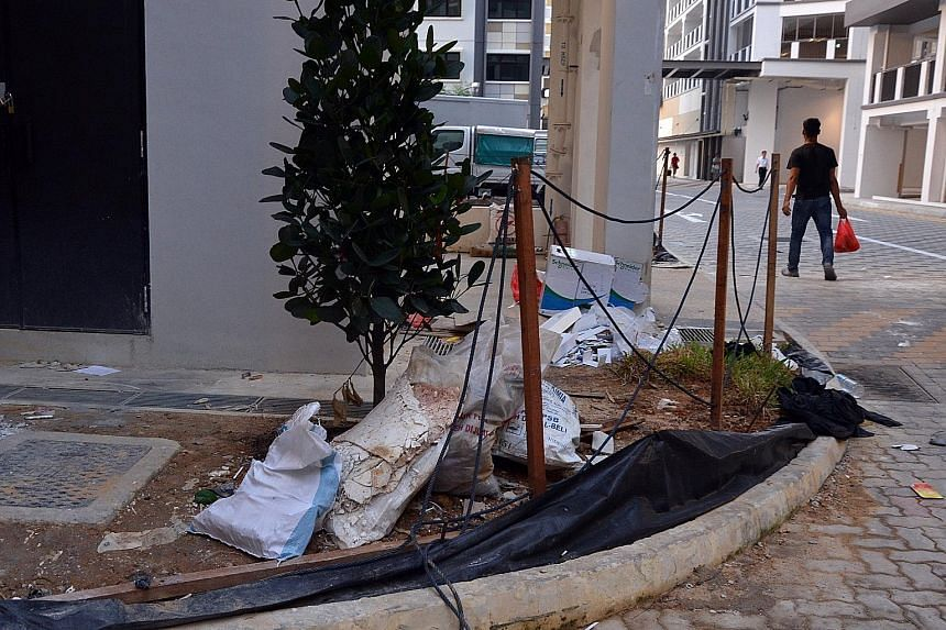 Construction materials and other bulky items were seen strewn about on the walkways and pavements around the new blocks in Choa Chu Kang Avenue 7 yesterday.