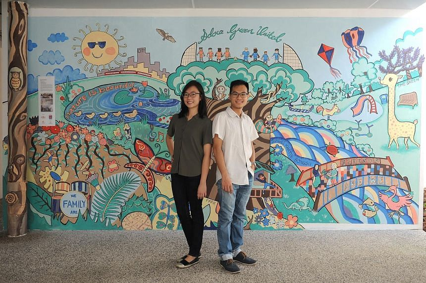 Ms Hoo Xin Yu and her husband Gilbert Cher kickstarted a community project involving some 100 residents to paint a mural on one of the void deck walls.