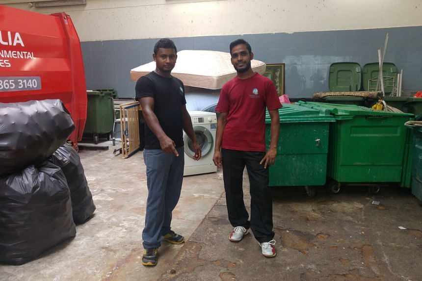 Mr Sentu (left) and Mr Nurul Islam show where they found the jewellery box in the bin centre near Stirling Road.