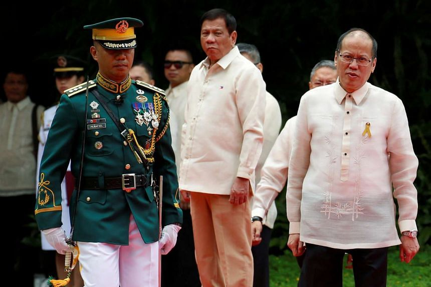 Incoming Philippines President Rodrigo Duterte (centre)and outgoing President Benigno Aquino at the Malacanang Palace in Manila.