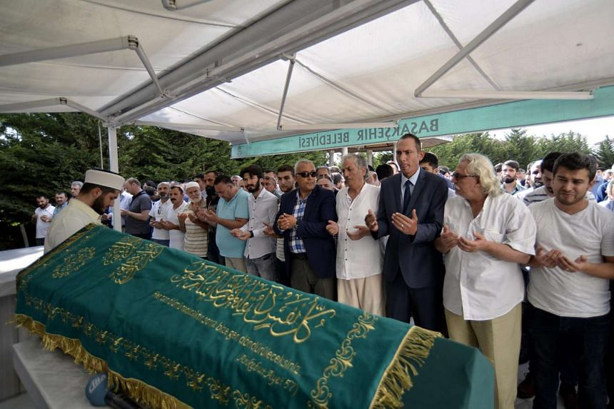 Relatives of Muhammed Egmen Demirci, who was killed in the attacks on June 28, pray during a funeral in Istanbul, Turkey, on June 29.