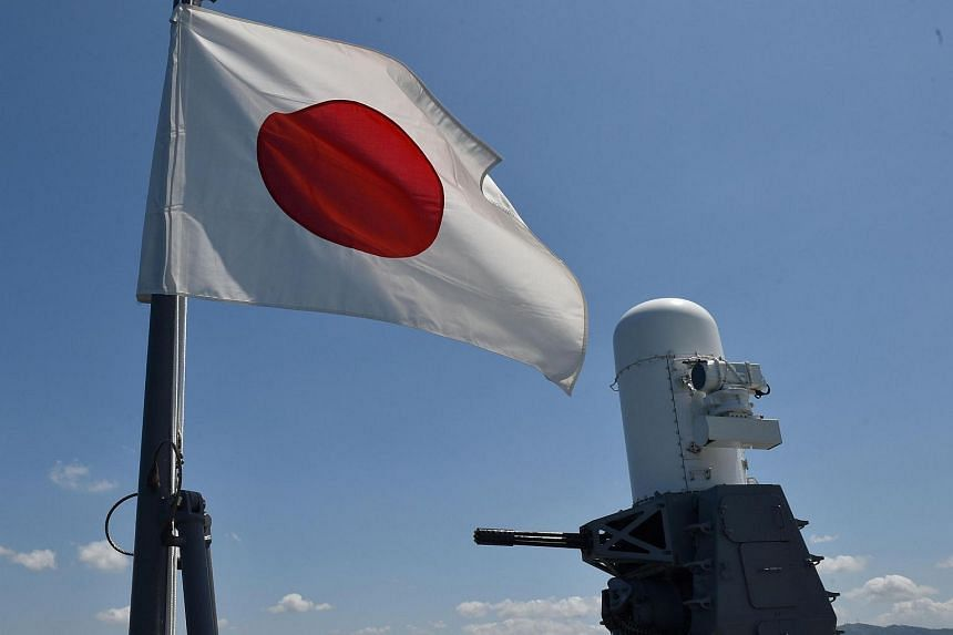 A Japanese flag aboard a helicopter carrier docked at a former US naval base north of Manila on April 26, 2016.