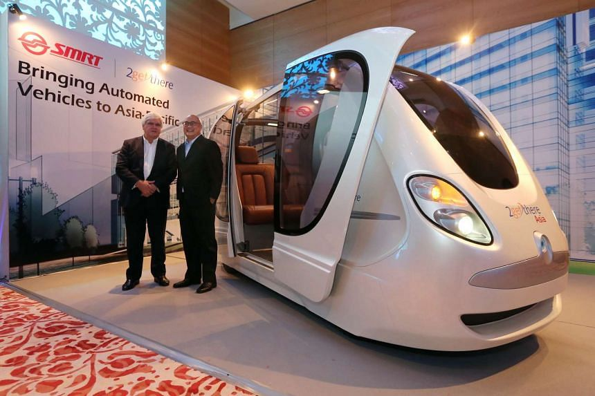 Mr Carel van Helsdingen (left), chairman and founder of 2getthere and Mr Colin Lim, managing director of SMRT Services, unveil a replica of the Personal Rapid Transit System (PRT) during a media conference held at the Grand Hyatt Hotel on April 20, 2