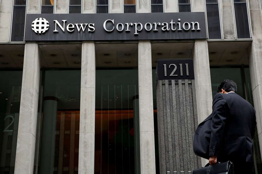 A man arrives at the News Corporation headquarters in Manhattan, New York, on April 29, 2016.