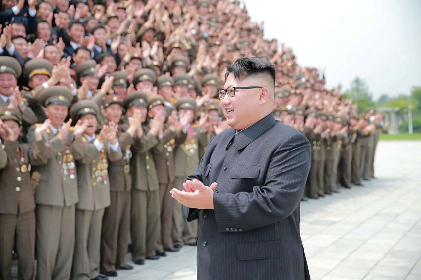 North Korean leader Kim Jong Un with officials in this undated photo by the Korean Central News Agency.