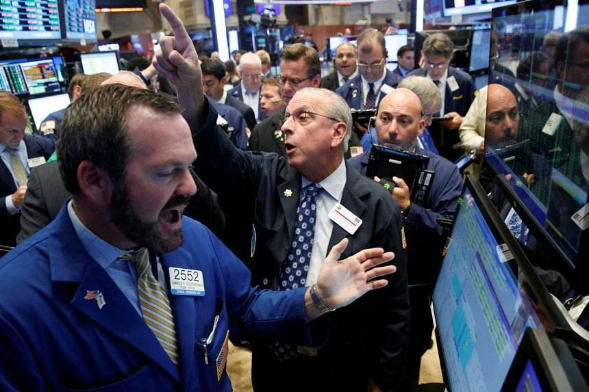 Traders work on the floor of the New York Stock Exchange on June 29, 2016.