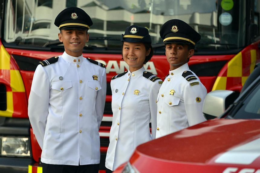 Lieutenant Lina Chan Kobayashi (centre) with her fellow officers, Captain Koh Guan Chong (left) and Lieutenant Rahul Swaminathan, at their commissioning on Wednesday (June 29).