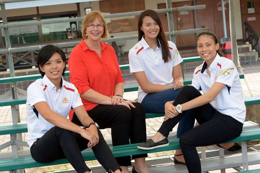 Under coach Ruth Aitken's tutelage, Singapore's new netball captain Vanessa Lee (right) and her team-mates Josephine Yeo (left), and Yu Mei Ling will be bidding to defend their crown at the Asian Championships next month. The returning Lee, in particular,