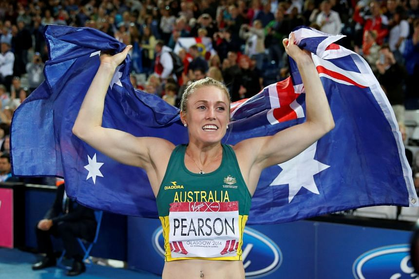 Australian hurdler Sally Pearson, seen here celebrating winning gold in the 100m hurdles at the 2014 Commonwealth Games in Glasgow, has been ruled out of August's Olympics in Brazil after a hamstring injury.