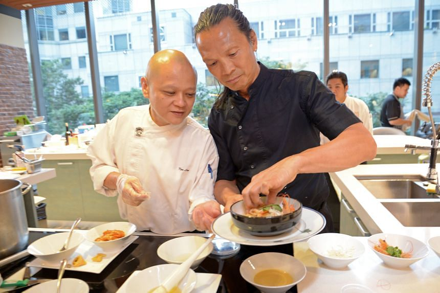 Ken Ling and Susur Lee (from left), who are preparing a dish of laksa chee cheong fun.