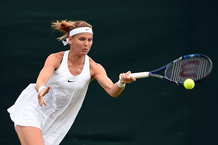Lucie Safarova sporting the shapeless Nike-issued dress at the All England Club. Her outfit wasn't enough to get in the way of her first-round win over Bethanie Mattek-Sands.