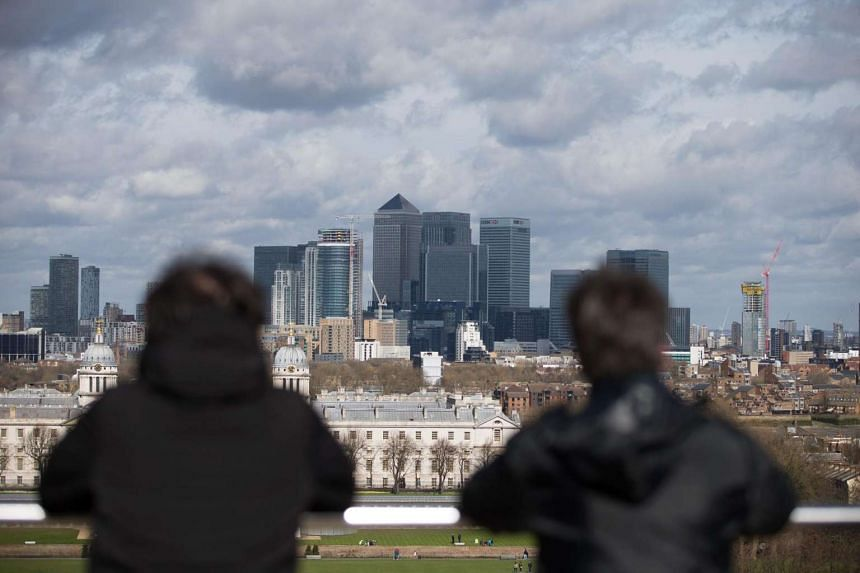 Visitors looking at the London skyline from the Royal Observatory in Greenwich, London, on June 28, 2016.