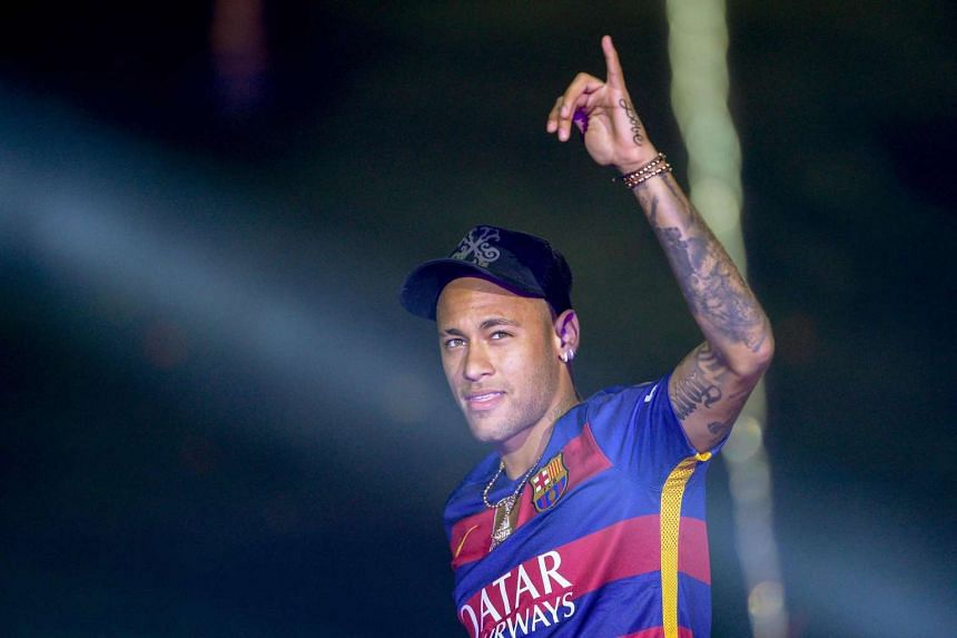 Barcelona's Brazilian forward Neymar acknowledges the crowd during celebrations at the Camp Nou stadium in Barcelona on May 23, 2016.