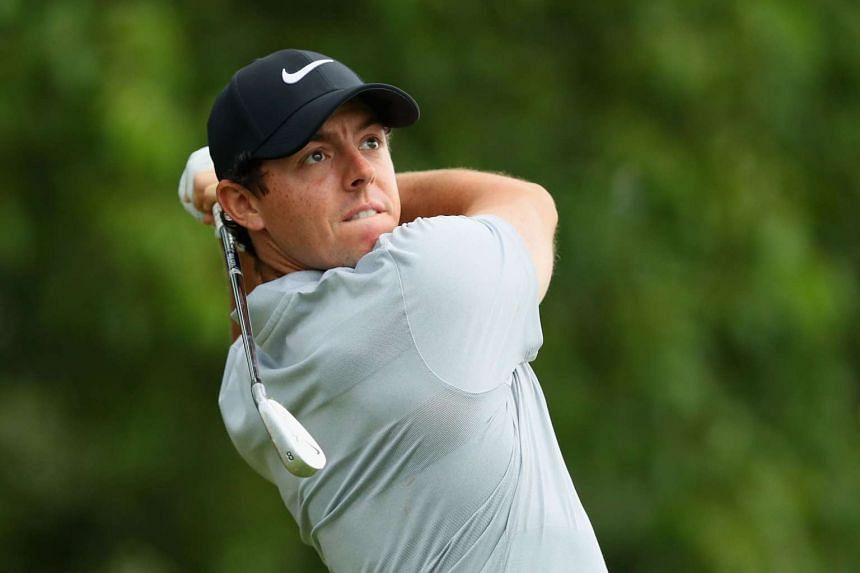 McIlroy (above, in a file photo) managed four birdies against four bogeys in an even par round of 71 to sit five adrift of the early lead.
