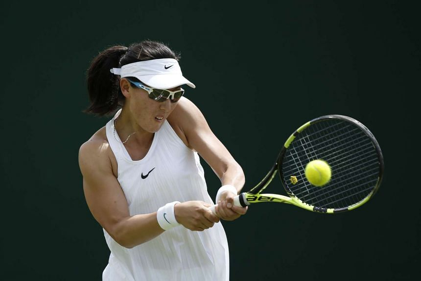 China's Zheng Saisai wears the Premier Slam dress during her match against Greece's Maria Sakkari on the first day of the 2016 Wimbledon Championships on June 27, 2016.