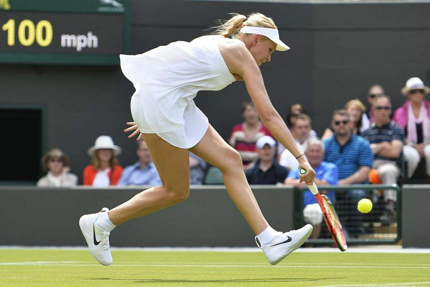 Donna Vekic of Croatia wears the Premier Slam dress during her match against Venus Williams of the US at the Wimbledon Championships on June 27, 2016.