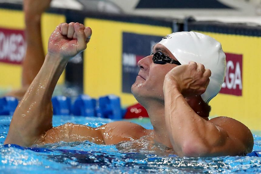 Nathan Adrian celebrates after winning the final heat for the Men's 100m freestyle at the 2016 US Olympic Team Swimming Trials on June 30, 2016.