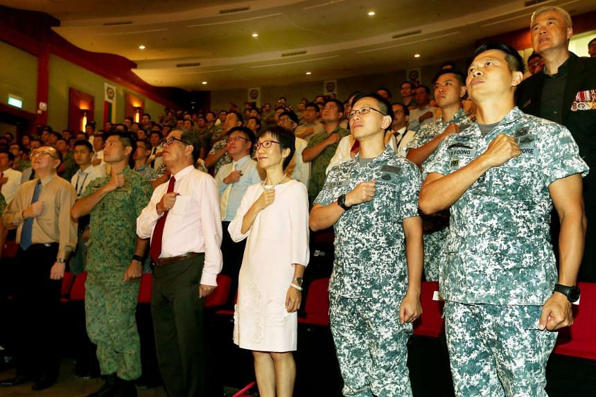 (From left) Professor Tan Thiam Soon, president, Singapore Institute of Technology and Ms Grace Fu, Minister for Culture, Community and Youth, reciting the pledge at the SAF Day combined rededication ceremony at the Singapore Institute of Technology.