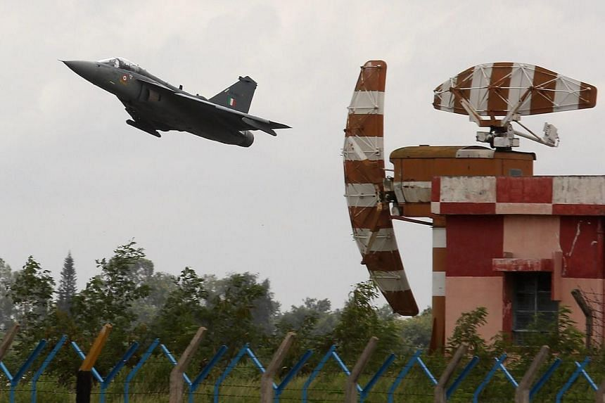 "An Indian Air Force ""Tejas"" Light Combat Aircraft takes off during a display, in Bangalore, on July 1, 2016."