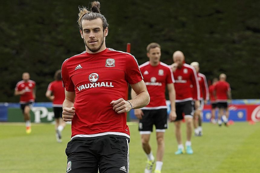 A relaxed and confident Gareth Bale during a Wales training session. His team-mates are no slouches but he will no doubt be their danger man again. The convivial atmosphere of the Wales camp and low-key build-up to big games are the perfect tonic for