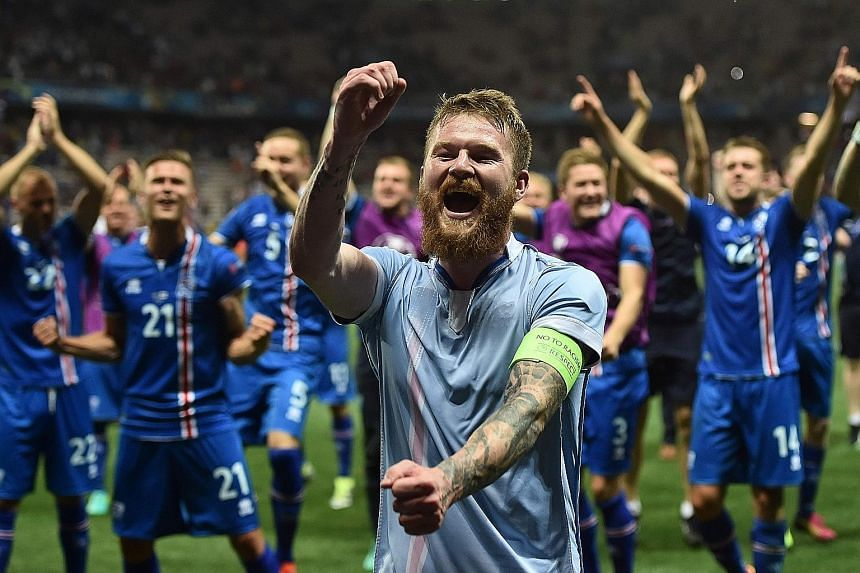 Iceland midfielder Aron Gunnarsson and team-mates celebrating after the come-from-behind 2-1 Euro victory that eliminated England in Nice on Monday.