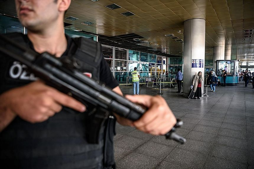 A Turkish anti-riot police officer on patrol at Ataturk airport. ISIS has been linked to at least five suicide attacks in Turkey in the past year, including two bombings in Istanbul earlier this year.