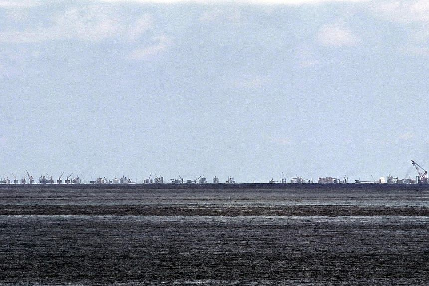 China appears to be continuing with its land reclamation works in the disputed Spratly Islands as seen in this file photo. The July 12 ruling will bring to a close Manila's 2013 case that challenges China's claims to nearly all of the South China Sea