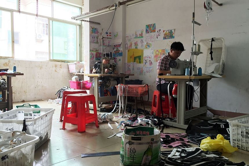 Workers at a factory producing bags in Guangdong province, China, on April 28, 2016.