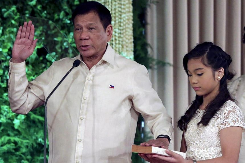 Rodrigo Duterte taking his oath during his inauguration ceremony at the Malacanang presidential palace grounds in Manila, Philippines, on June 30.