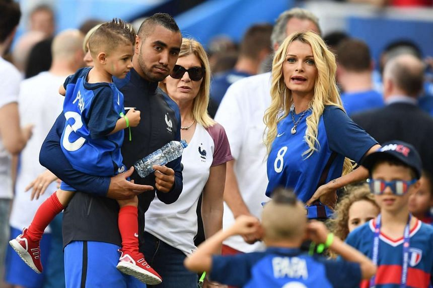 French forward Dimitri Payet with his wife Ludivine (right).