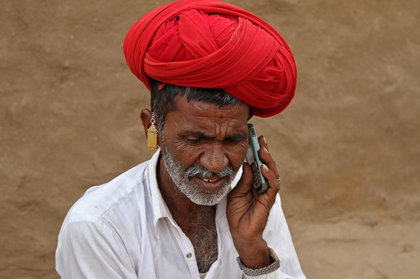 A man talking on his mobile phone in the village of Devmali in the state of Rajasthan, India, on June 14.