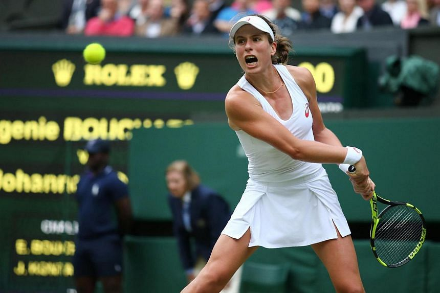 Britain's Johanna Konta returns to Canada's Eugenie Bouchard during their women's singles second round match on the fourth day of the 2016 Wimbledon Championships on June 30, 2016.