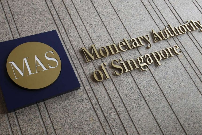 The logo of the Monetary Authority of Singapore (MAS) at its building.