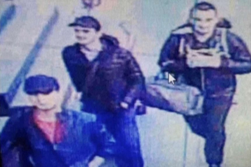 A still image from CCTV camera shows the three men believed to be the attackers walking inside the terminal building at Istanbul airport on June 28, 2016.