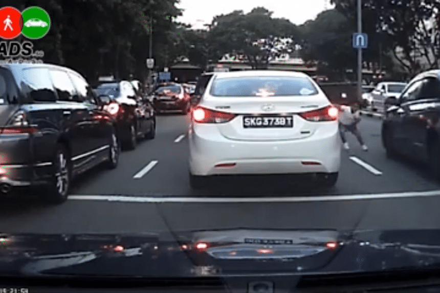 The car in the rightmost lane almost crashed into the boy when he dashed out from the second lane.